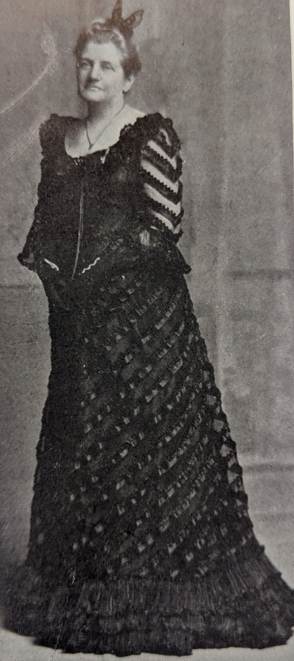 An image of Janet Randolph taken from a souvenir book commemorating the Jefferson Davis Memorial. She is wearing a long black gown.